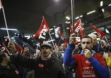Picketers from workers' and trade unions shout slogans at Atocha rail station during a 24-hour nationwide general strike in Madrid, November 14, 2012. REUTERS/Paul Hanna