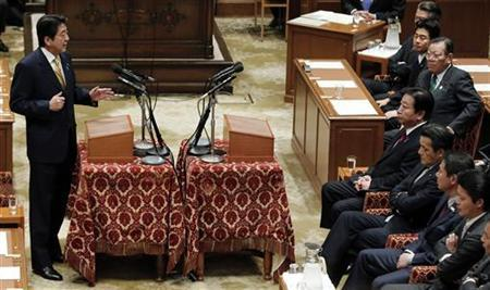 Japan's main opposition Liberal Democratic Party (LDP) leader Shinzo Abe (L) speaks against Japanese Prime Minister Yoshihiko Noda (centre on R) at a parliamentary debate in Tokyo November 14, 2012. REUTERS/Kim Kyung-Hoon