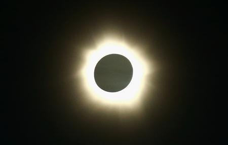 The moon passes in front of the sun during a full solar eclipse at Palm Grove near the northern Australian city of Cairns November 14, 2012. REUTERS/Tourism Queensland/Handout