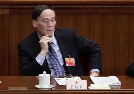 China's Vice Premier Wang Qishan attends a plenary meeting of the National People's Congress (NPC), China's parliament, at the Great Hall of the People in Beijing, March 8, 2012. REUTERS/Jason Lee/Files