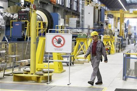 An employee of Siemens AG walks through the gas turbine factory hall in Berlin November 8, 2012. REUTERS/Tobias Schwarz