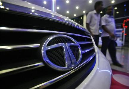 Men walk inside a Tata Motors showroom on the outskirts of Agartala, capital of Tripura, November 7, 2012. REUTERS/Jayanta Dey