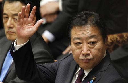 Japan's Prime Minister Yoshihiko Noda raises his hands next to Deputy Prime Minister Katsuya Okada as they attend the lower house budget committee meeting in Tokyo November 12, 2012. REUTERS/Yuriko Nakao