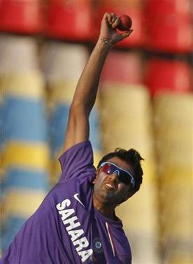 Ravichandran Ashwin bowls during a cricket practice session in Ahmedabad November 12, 2012. REUTERS/Amit Dave