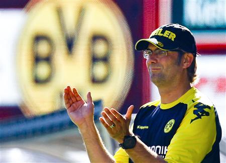 File picture shows Borussia Dortmund's coach Juergen Klopp as he celebrates a goal of his team during the German Bundesliga first division soccer match against 1. FC Kaiserslautern in Kaiserslautern, April 28, 2012. A church in western Germany has bowed to public pressure and allowed the parents of a soccer-mad nine-year old boy who died from a brain tumour to erect a gravestone with a football after a Facebook campaign spawned more than 100,000 angry messages. REUTERS/Ralph Orlowski/File