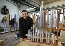 German organ builder Philipp Klais is pictured in front of organ pipes in his workshop in Bonn November 13, 2012. REUTERS/Wolfgang Rattay