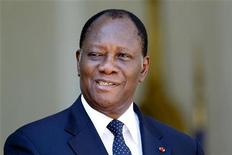 Ivory Coast's President Alassane Ouattara smiles after a meeting with France's President at the Elysee Palace in Paris July 26, 2012. REUTERS/Charles Platiau