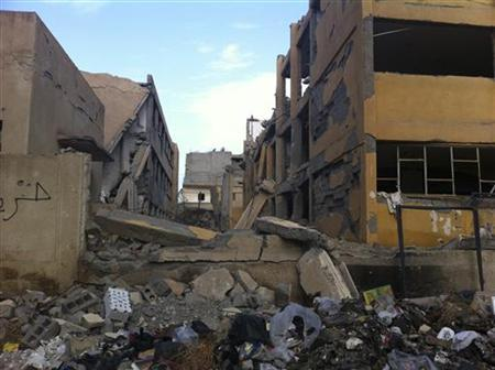 A school lies damaged after a Syrian Air Force fighter jet loyal to Syria's President Bashar al-Assad fired missiles at Deir Al-Zor November 13, 2012. REUTERS/Muhamad Al-Younis/Shaam News Network/Handout