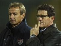 Russia coach Fabio Capello (R) and U.S. coach Jurgen Klinsmann watch their teams during their international friendly soccer match in Krasnodar November 14, 2012. REUTERS/Vitaliy Timkiv