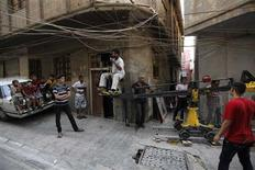 A film crew shoots a scene of an Iraqi film in a street in Baghdad October 18,2012. REUTERS/Mohammed Ameen