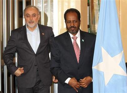 Somalia's President Hassan Sheikh Mohamud (R) and Iranian Foreign Minister Ali Akbar Salehi pose for photographs before addressing a joint news conference in Mogadishu November 14, 2012. REUTERS/Omar Faruk