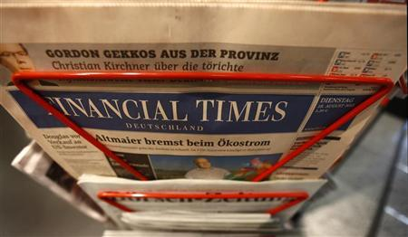 An edition of the Financial Times Deutschland (Germany) is seen at a shop in Frankfurt August 28, 2012. REUTERS/Kai Pfaffenbach