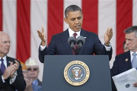 U.S. President Barack Obama acknowledges the audience's applause as he stands for Veterans Day remarks at Arlington National Cemetery in Arlington, Virginia, November 11, 2012. REUTERS/Jonathan Ernst
