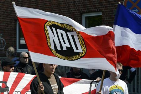 Supporters of the National Democratic Party of Germany (NPD) march during May Day demonstrations in Neumunster May 1, 2012. REUTERS/Fabian Bimmer