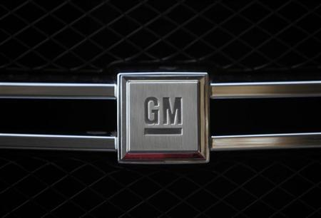 A GM logo is seen on a Hydrogen car during a presentation in Berlin, August 28, 2009. REUTERS/Pawel Kopczynski