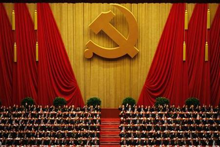 A general view shows delegates raising their hands as they take a vote at the closing session of 18th National Congress of the Communist Party of China at the Great Hall of the People in Beijing, November 14, 2012. REUTERS/Carlos Barria