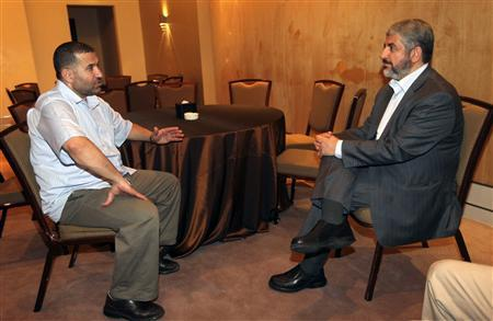 Hamas leader Khaled Meshaal (R) meets with Ahmed Al-Jaabari, top commander of Hamas' armed wing Al-Qassam brigades, after a prisoner swap deal between Hamas and Israel, in Cairo, in this October 18, 2011 file photo. REUTERS/Hamas Office/Handout/Files