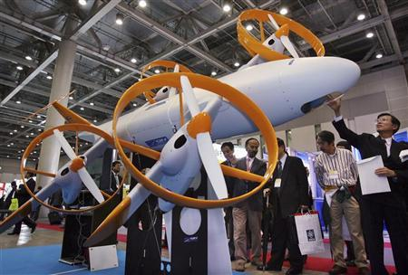 Japanese composite engineering and manufacturing company GH craft's prototype of an UAV (unmanned air vehicle) is displayed at the Security and Safety Trade Expo at Tokyo Big Sight (Tokyo International Exhibition Centre) October 24, 2006. REUTERS/Yuriko Nakao