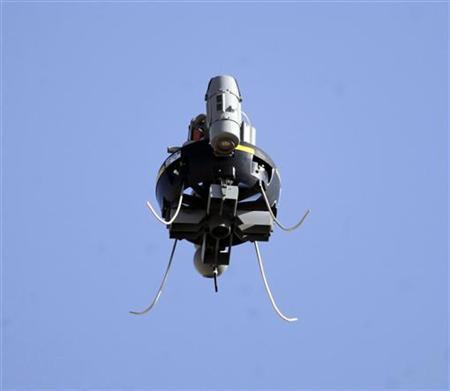 A U.S. military surveillance drone camera flies in Musa Qal-Ah district in Helmand province, southwestern Afghanistan November 2, 2012. REUTERS/Erik De Castro