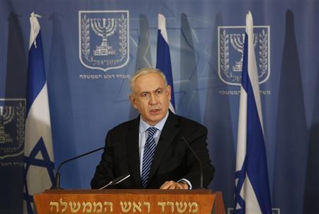 Israel's Prime Minister Benjamin Netanyahu delivers a statement to the media in Tel Aviv November 14, 2012. Israel launched a major offensive against Palestinian militants in Gaza on Wednesday, killing the military commander of Hamas in an air strike and threatening an invasion of the enclave that the Islamist group vowed would ''open the gates of hell''. REUTERS/Ronen Zvulun