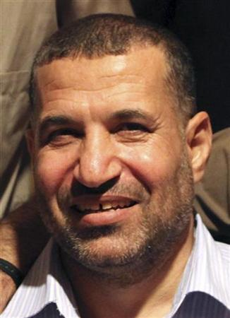 Ahmed Al-Jabari, top commander of Hamas armed wing Al-Qassam brigades, poses for a picture after a prisoner swap deal between Hamas and Israel, in Cairo, in this October 18, 2011 file photo. REUTERS/Hamas Office/Handout/Files