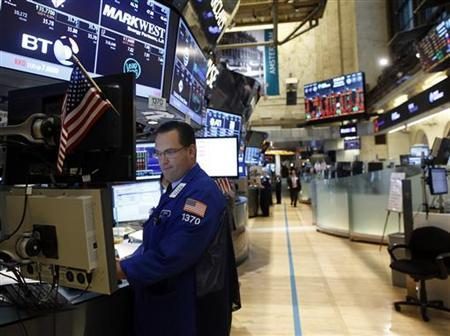 Trading specialist Anthony Matesic watches trades on companies including Mark West Energy, from his trading station on the floor of the New York Stock Exchange, November 14, 2012. REUTERS/Chip East