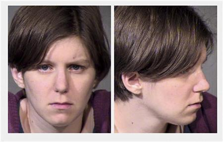 Holly Nicole Solomon is shown in her booking photo taken from the Maricopa County (AZ) Sheriff's website, released to Reuters November 12, 2012. Solomon is alleged to have run down her husband in the family car after she found he had not voted in the presidential election. REUTERS/Maricopa Sheriff's Department/Handout (