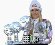 Lindsey Vonn from the U.S. poses with her trophies after winning the women's overall, downhill, super G and combined World Cup at the Alpine skiing World Cup finals in Schladming March 18, 2012. REUTERS/Erich Spiess/OESV/Handout
