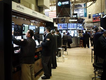 Trading specialists from Jefferies (L) work on the floor of the New York Stock Exchange, November 14, 2012. REUTERS/Chip East