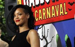 Singer Rihanna poses as she arrives at a reception in West Hollywood, California October 31, 2012. REUTERS/Mario Anzuoni