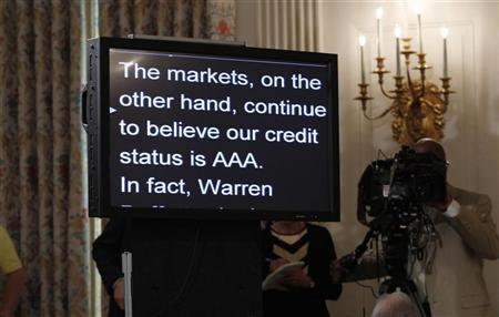 A teleprompter being read by President Barack Obama shows a sentence written in defiance of the lowering of the U.S. credit rating in the State Dining Room of the White House in Washington, August 8, 2011. REUTERS/Jason Reed