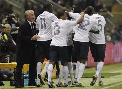 France's coach Didier Deschamps celebrates with his players after Bafetimbi Gomis (hidden) scored a second goal against Italy during their international friendly soccer match at the Tardini stadium in Parma November 14, 2012. REUTERS/Alessandro Garofalo