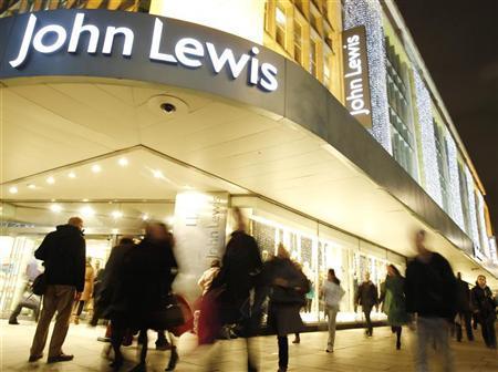 Shoppers pass John Lewis department store on Oxford Street in London December 8, 2011. REUTERS/Luke MacGregor