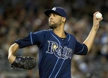 Tampa Bay Rays starting pitcher David Price throws a pitch to the New York Yankees in the first inning of their MLB American League game at Yankee Stadium in New York, September 14, 2012. REUTERS/Ray Stubblebine