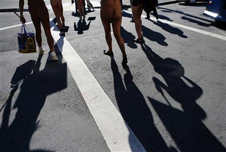 Nudists march to city hall during a rally against banning nudity in parts of the city in San Francisco, California, November 14, 2012. REUTERS/Beck Diefenbach