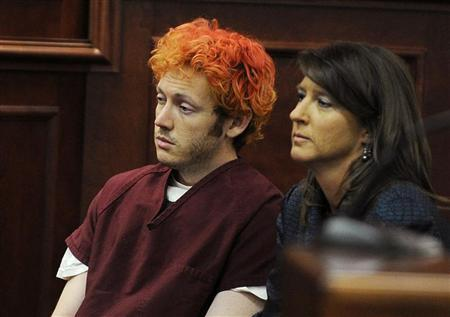 Colorado shooting suspect James Eagan Holmes (L) sits with public defender Tamara Brady during his first court appearance in Aurora, Colorado, July 23, 2012. REUTERS/RJ Sangosti/Pool