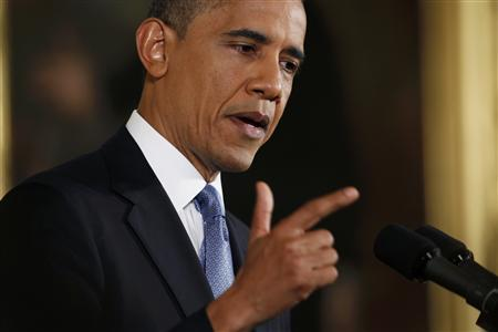 U.S. President Barack Obama gestures while addressing his first news conference since his reelection, at the White House in Washington November 14, 2012. REUTERS/Kevin Lamarque