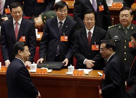 Xi Jinping (front L) and Vice-Premier Li Keqiang (front R) leave their seats after the closing session of 18th National Congress of the Communist Party of China at the Great Hall of the People in Beijing, November 14, 2012. REUTERS/Jason Lee