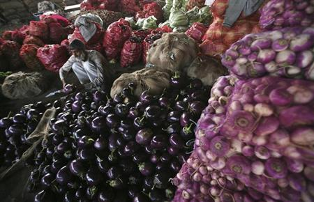 A vendor waits for customers at a wholesale vegetable market on the outskirts of Jammu November 14, 2012. REUTERS/Mukesh Gupta