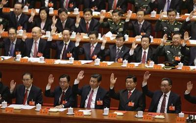 China Communist Party unveils new leadership with Xi...