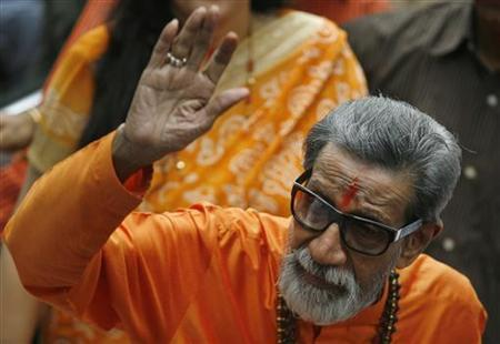 Bal Thackeray, chief of Shiv Sena, waves towards the media as he arrives to cast his vote at a polling centre during Maharashtra elections in Mumbai October 13, 2009. REUTERS/Punit Paranjpe/Files