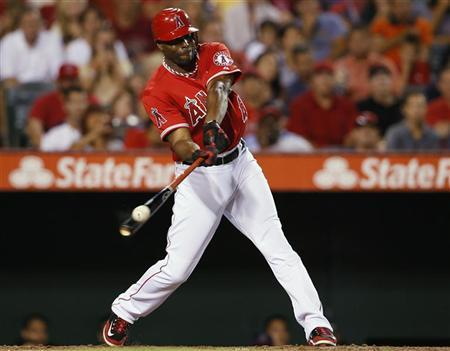 Los Angeles Angels Torii Hunter hits an RBI double to score teammate Mike Trout during the third inning of their MLB American League baseball game against the Oakland Athletics in Anaheim, California September 10, 2012. REUTERS/Lucy Nicholson