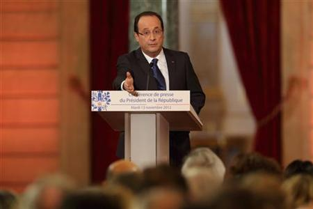 France's President Francois Hollande addresses a news conference at the Elysee Palace in Paris, November 13, 2012. Picture taken November 13, 2012. REUTERS/Philippe Wojazer