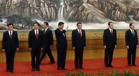 China's new Politburo Standing Committee members (from L to R) Liu Yunshan, Zhang Dejiang, Zhang Gaoli, Xi Jinping, Li Keqiang, Yu Zhengsheng and Wang Qishan arrive to meet with the press at the Great Hall of the People in Beijing, November 15, 2012. REUTERS/Carlos Barria