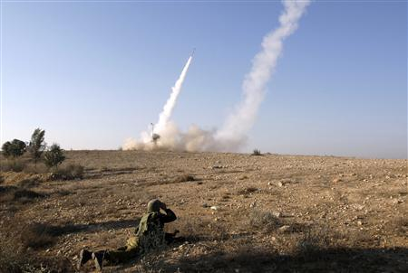 An Israeli soldier watches as an Iron Dome launcher fires an interceptor rocket near the southern city of Beersheba November 15, 2012. REUTERS/Baz Ratner
