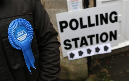 A rosette is seen on a Conservative teller outside a polling station in Oundle, near Corby, central England November 15, 2012. REUTERS/Eddie Keogh