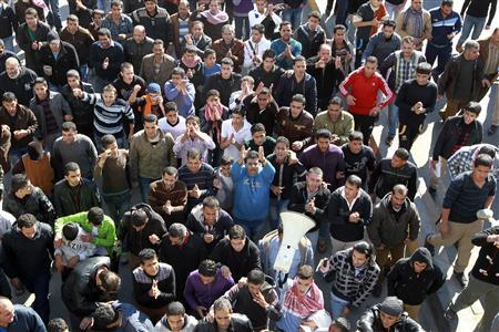 Anti-government protesters shout slogans during a demonstration following an announcement that Jordan would raise fuel prices, including a hike on cooking gas, in Amman November 14, 2012. REUTERS/Muhammad Hamed