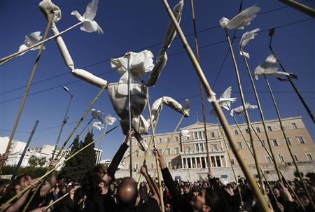 Protesters use a life-size puppet made of paper symbolizing a Greek during an anti-austerity rally in front of the parliament building in central Athens November 14, 2012. REUTERS/John Kolesidis