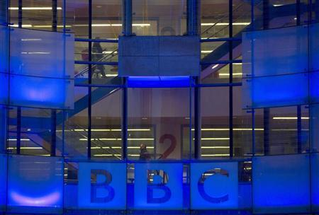 People walk inside the BBC headquarters at New Broadcasting House in central London November 12, 2012. REUTERS/Neil Hall