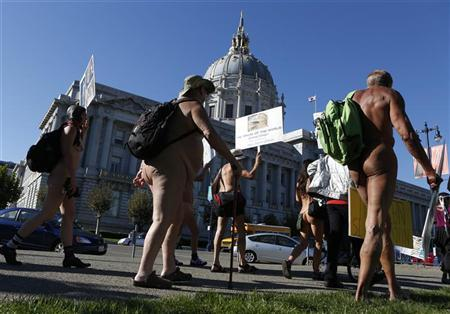 Nudists march past city hall during a rally against banning nudity in parts of the city in San Francisco, California, November 14, 2012. REUTERS/Beck Diefenbach